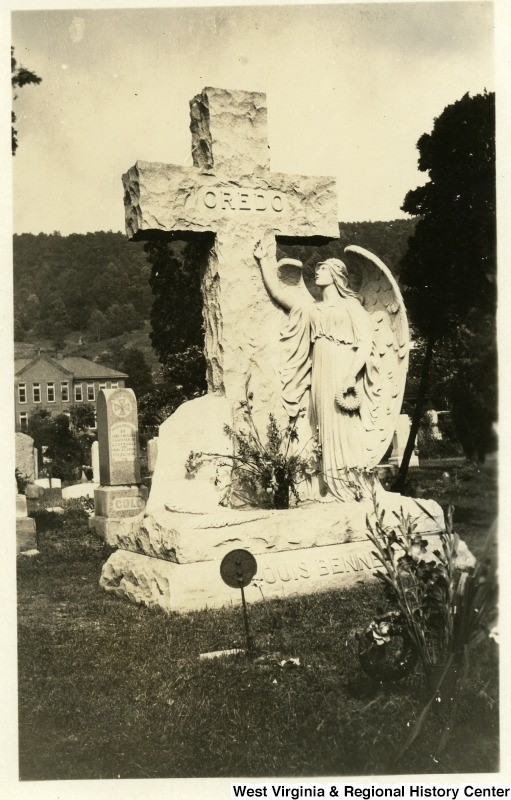 Memorial/cemetery marker for Louis Bennett, Jr., showing a cross and an angel