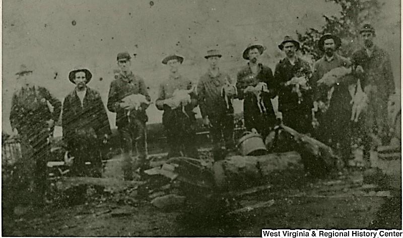 A group of men plucking turkeys