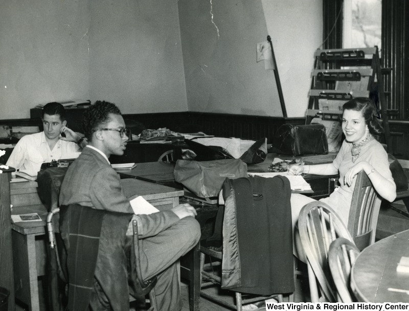 Jack Hodge and others at a student news group meeting in Woodburn Hall circa 1953
