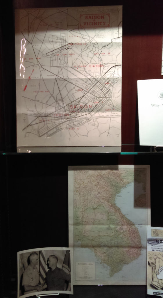 Display case containing maps