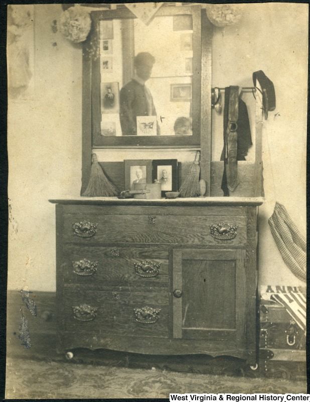 Chest of drawers and mirror in men's dorm room