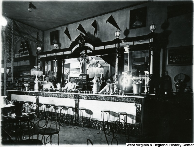Interior of a drugstore in Morgantown, showing the soda fountain/counter area