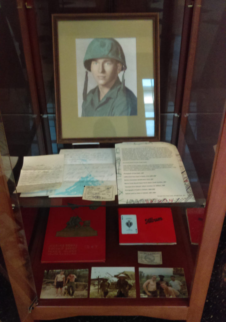 Display case containing Vietnam War materials related to veteran Paul Casto