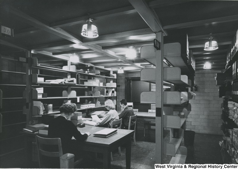 People working at desks on the 10th Floor of Wise Library, West Virginia University