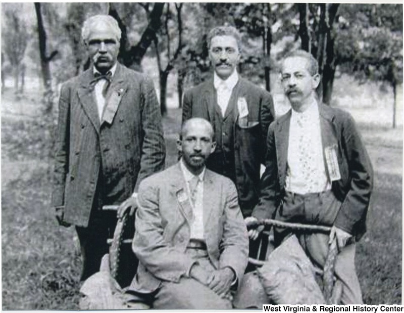 Outdoor portrait of men of the Niagara movement: W.E.B. DuBois (seated) and (left to right) J.R. Clifford, I.M. Hershaw, and F.H.M. Murray at Harpers Ferry, 1906