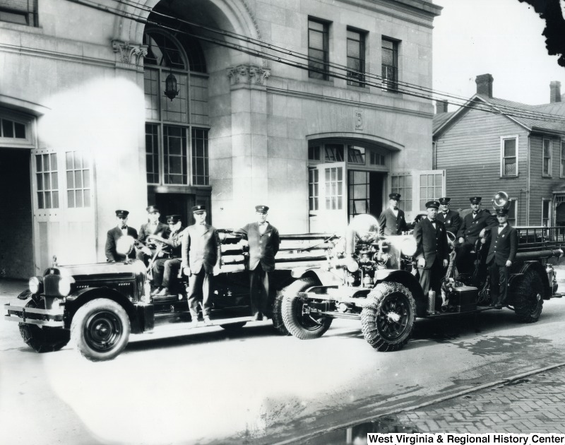 Morgantown Fire Department outdoor group photo including two vehicles and bulldog Doc