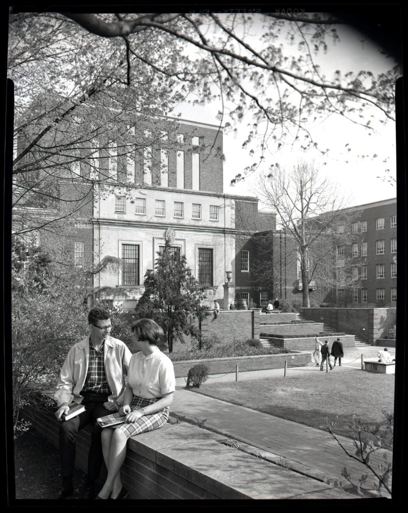 Facade of Wise Library at WVU, May 1967, with students in foreground
