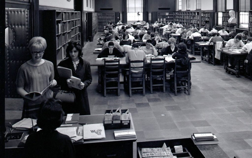 Reading room in Wise Library, full of students studying at tables, March 1966