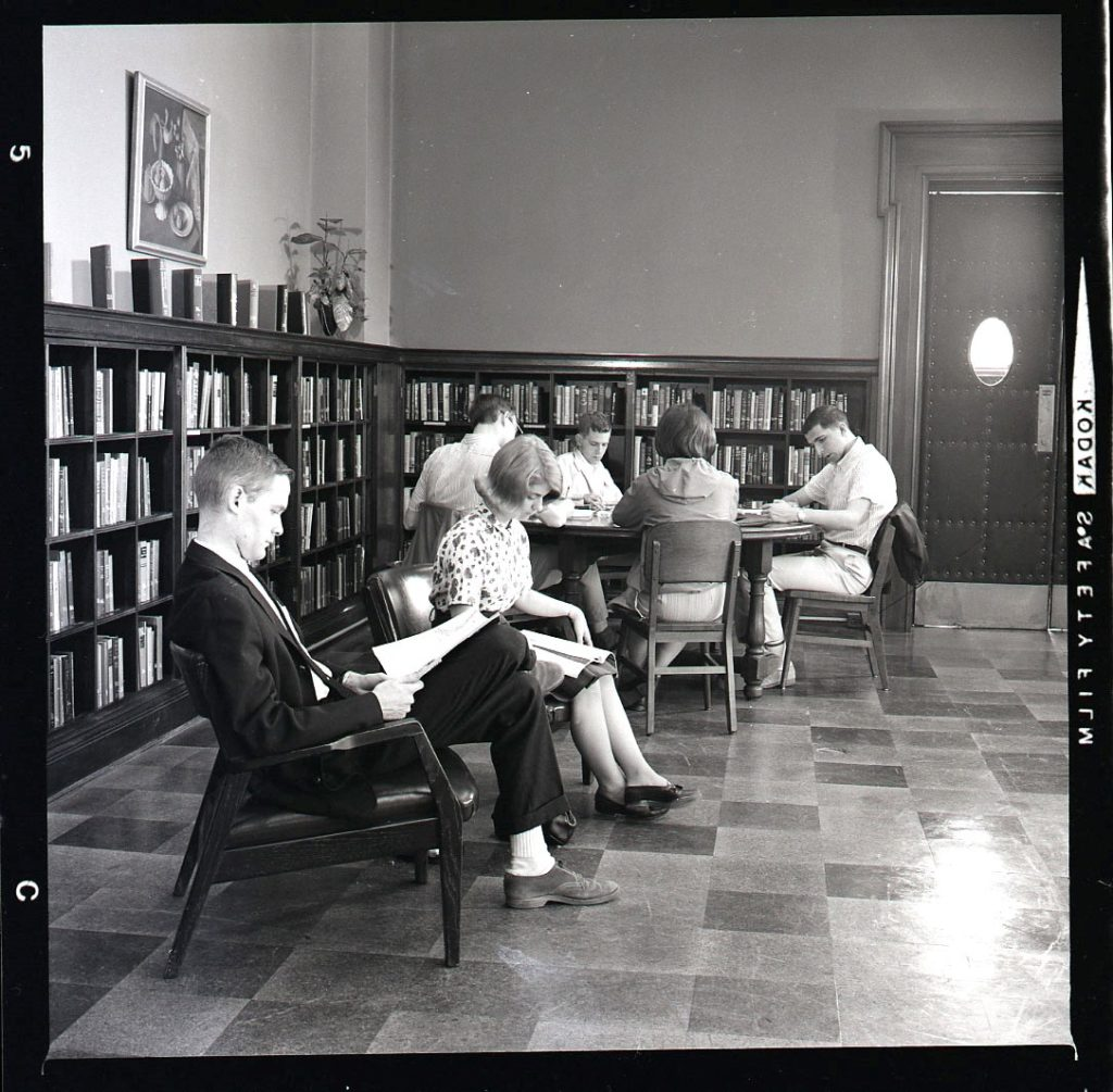 Multiple students studying in corner of reading room, Wise Library, May 1965