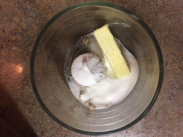 Mixing bowl containing butter and sugar