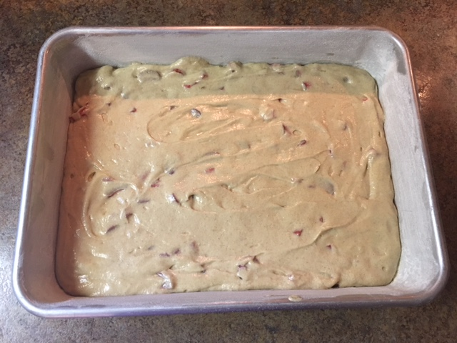 Baking dish with rhubarb cake batter in it