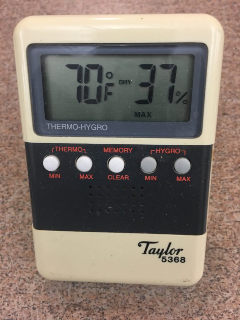 Hygrometer/thermometer showing 70 degrees and 37 percent humidity