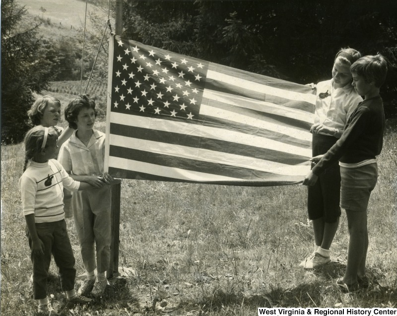Children holding up an American flag