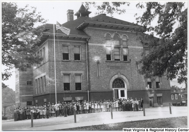 outside the Greebrier School, Hinton, W. Va., ca. 1950, pledging allegiance to the American flag