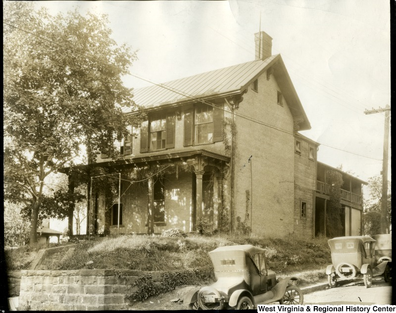 The Hayes family home, with two cars next to it
