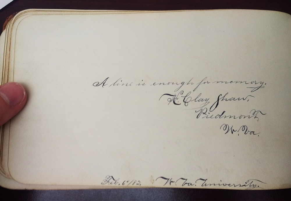 "Page from autograph book that says ""A line is enough for memory"" with a signature beneath"