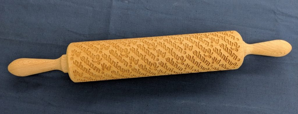 """Laser cut rolling pin that says """"Made by Lucinda Ebersole"""""""