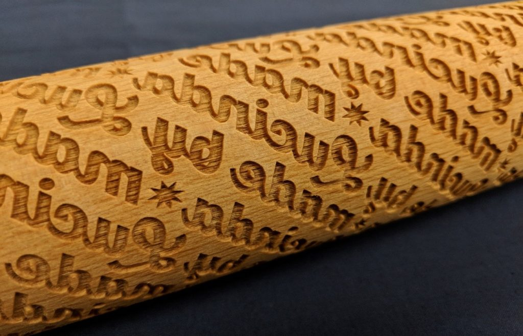 "Close up of laser cut rolling pin that says ""Made by Lucinda Ebersole"""