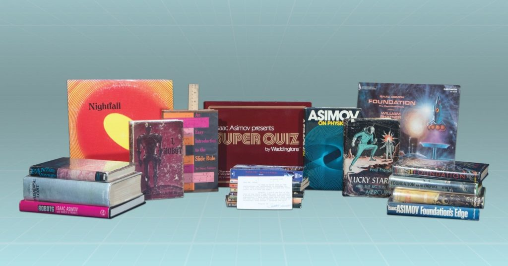 Assortment of Asimov-related books and a game