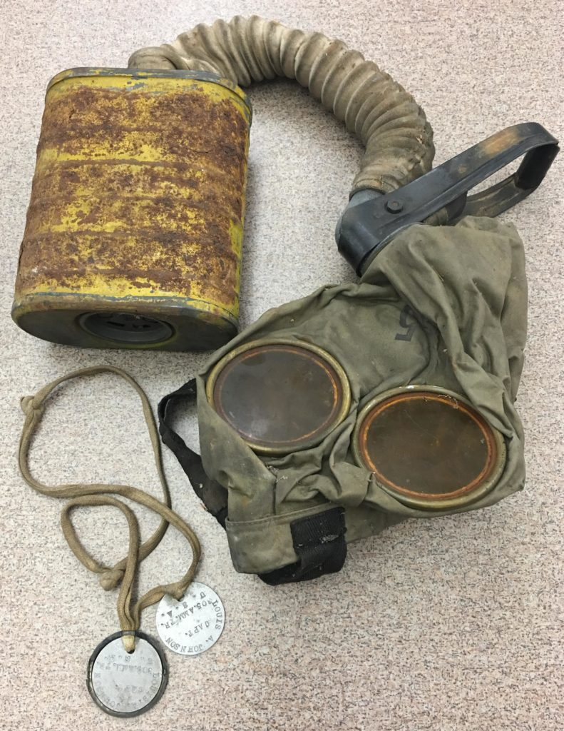 Gas Mask and Tags belonging to Louis A. Johnson, ca. 1918
