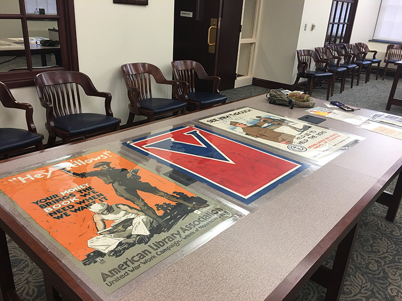 Three United War Work Campaign Posters, 1918, laid out on a table