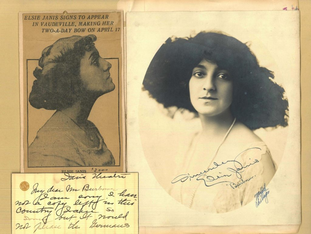 Newspaper clipping about Elsie Janis, note card in her handwriting, and a portrait photo of her