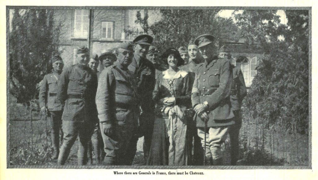 Outdoor photo of Elsie Janis meeting officers and generals of the AEF