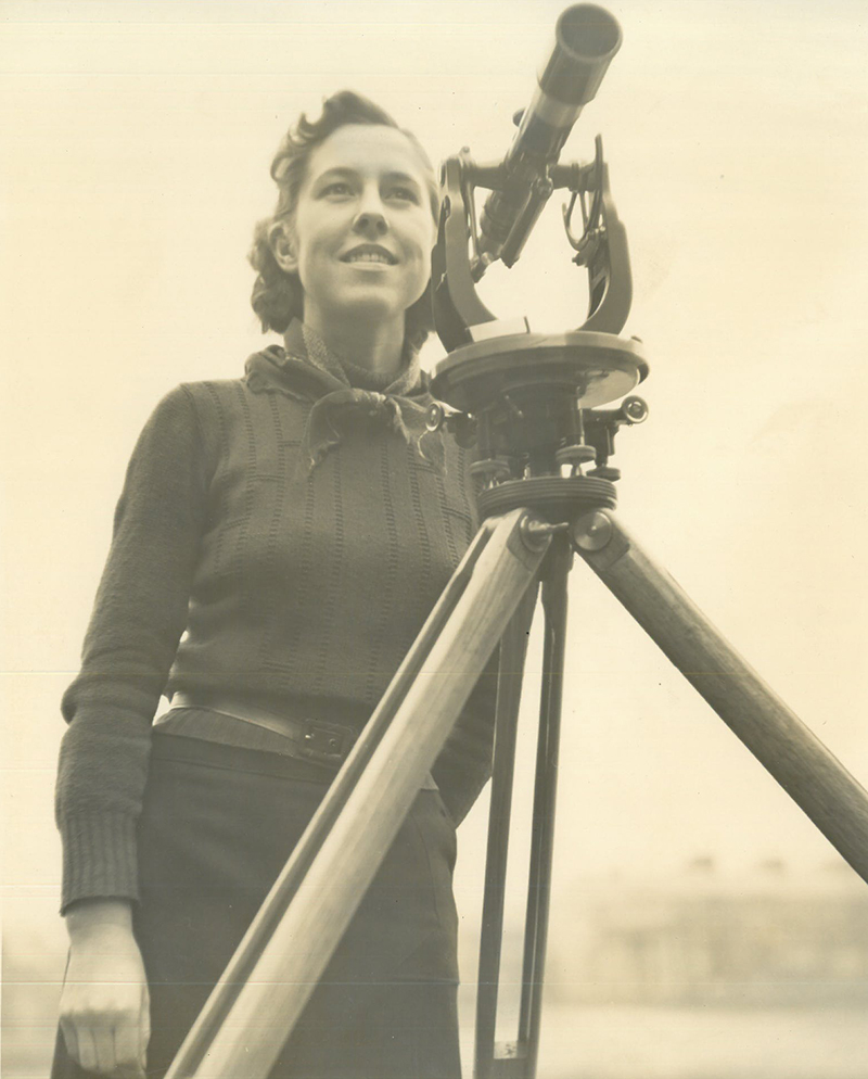 Portrait of Esther Benford in front of an engineering tool