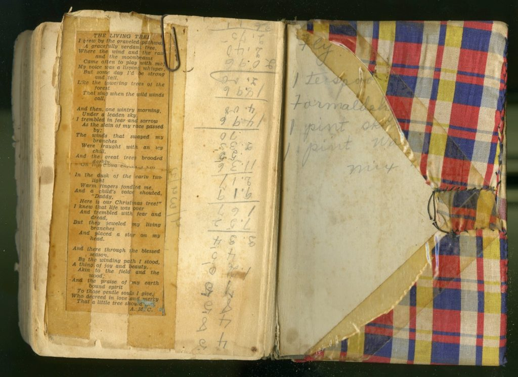 Inside back cover of cookbook, showing how the cover was sewn over the boards, and showing notes and a clipping on the endpaper