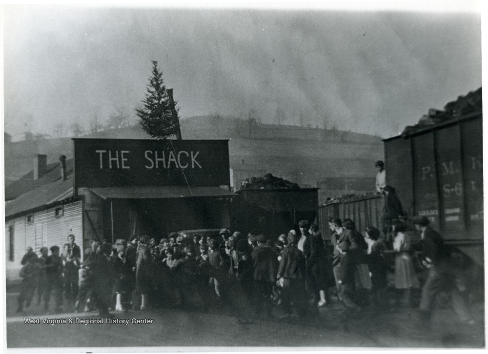 "Group of children in front of building labeled ""The Shack"" for Christmas Party"