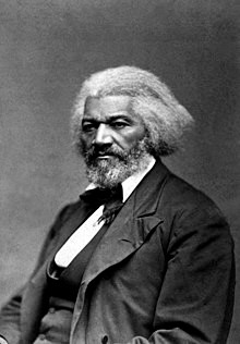 Black and white portrait photo of Frederick Douglass as an older man