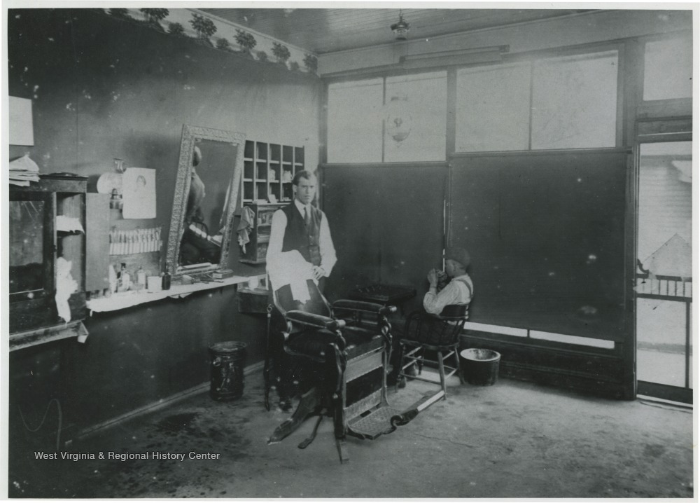 Barber standing in the interior of his shop