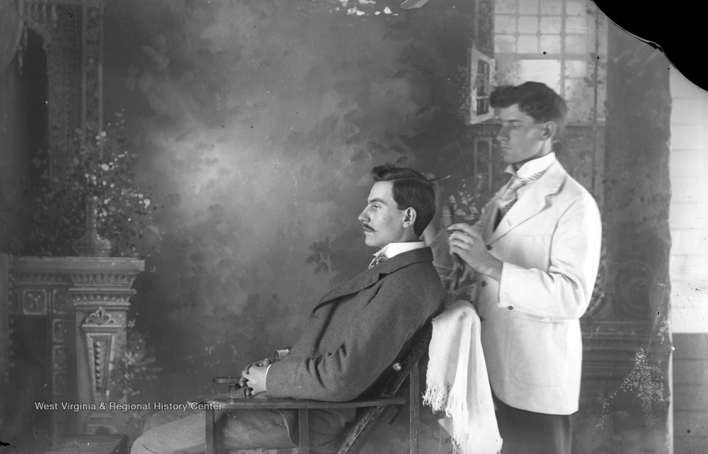 Barber brushing man's hair
