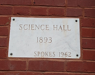 "Plaque on bricks, ""Science Hall / 1893 / Spokes 1962"""