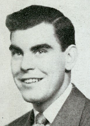 Black and white headshot-style portrait of a young man