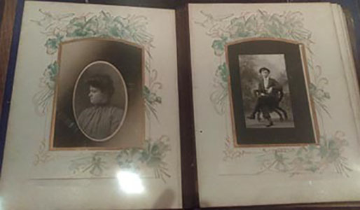 Photo album pages, showing a portrait of a woman and a seated portrait of a man