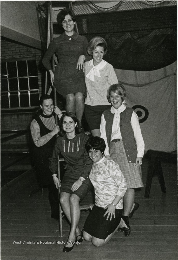 Interior group portrait of six college age women