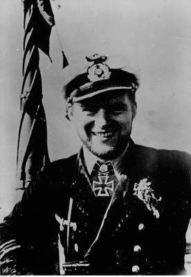 Portrait of a smiling Albrecht Brandi in uniform.