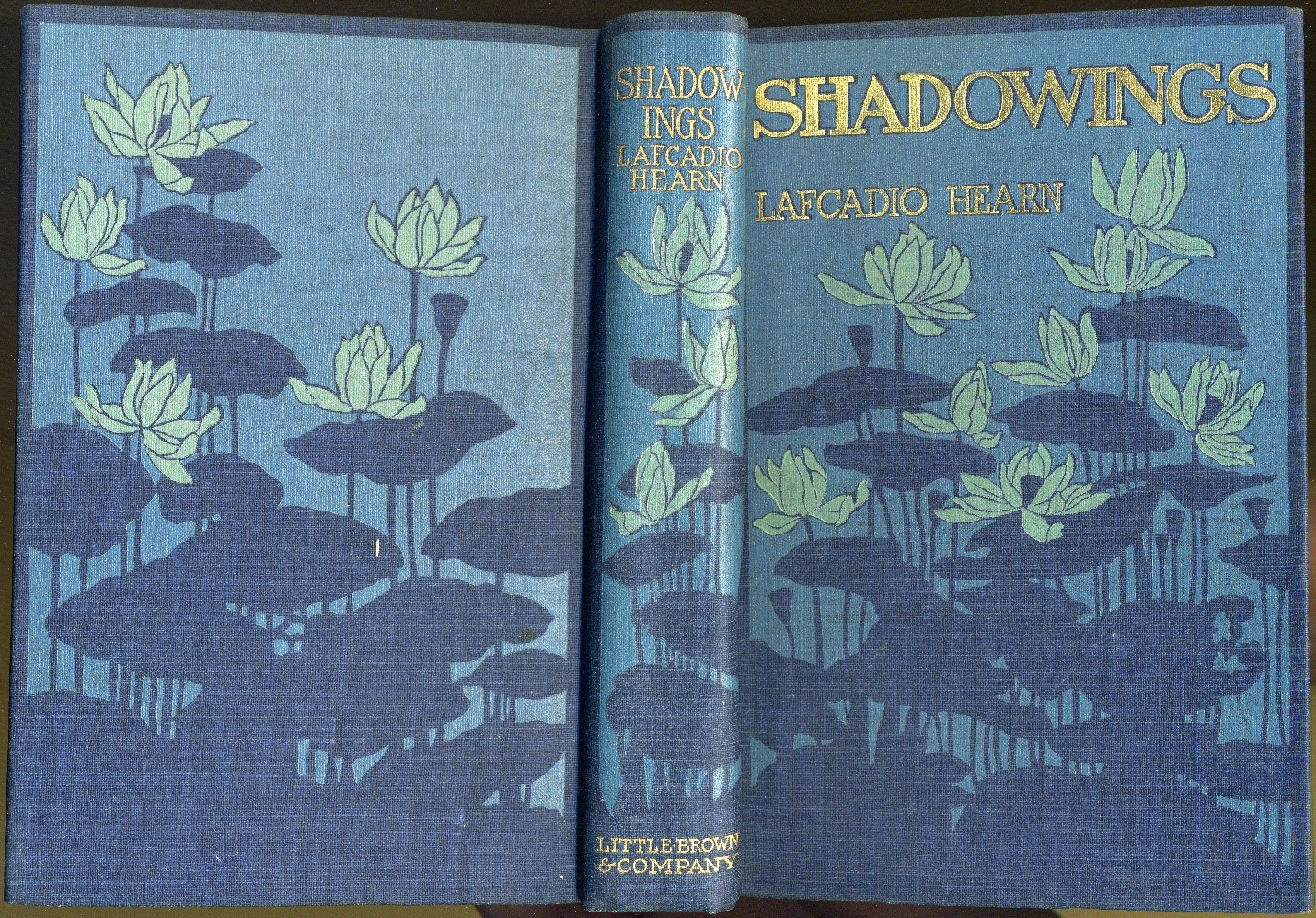 Front and back covers and spine of Shadowings book, with lotus flower motif