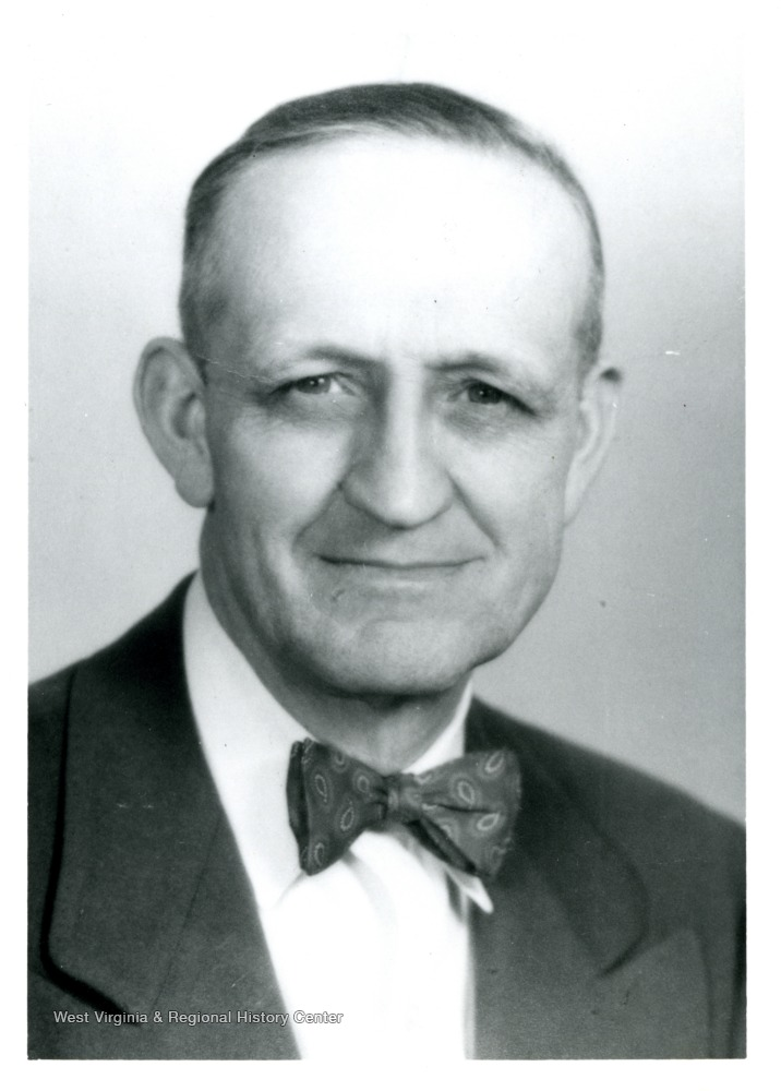 Portrait photo of Harry Stansbury in a bow tie