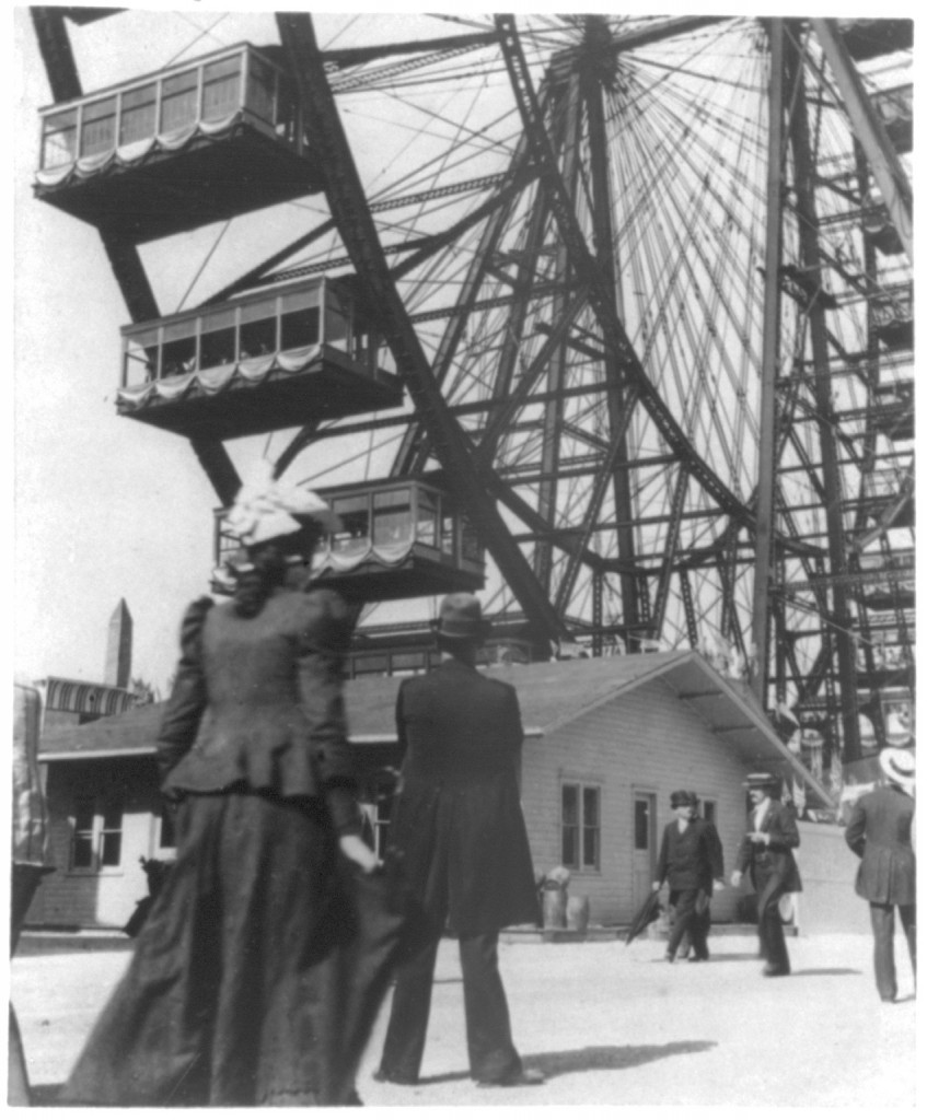 View of the world's first Ferris Wheel from the ground, showing a few of the cars.