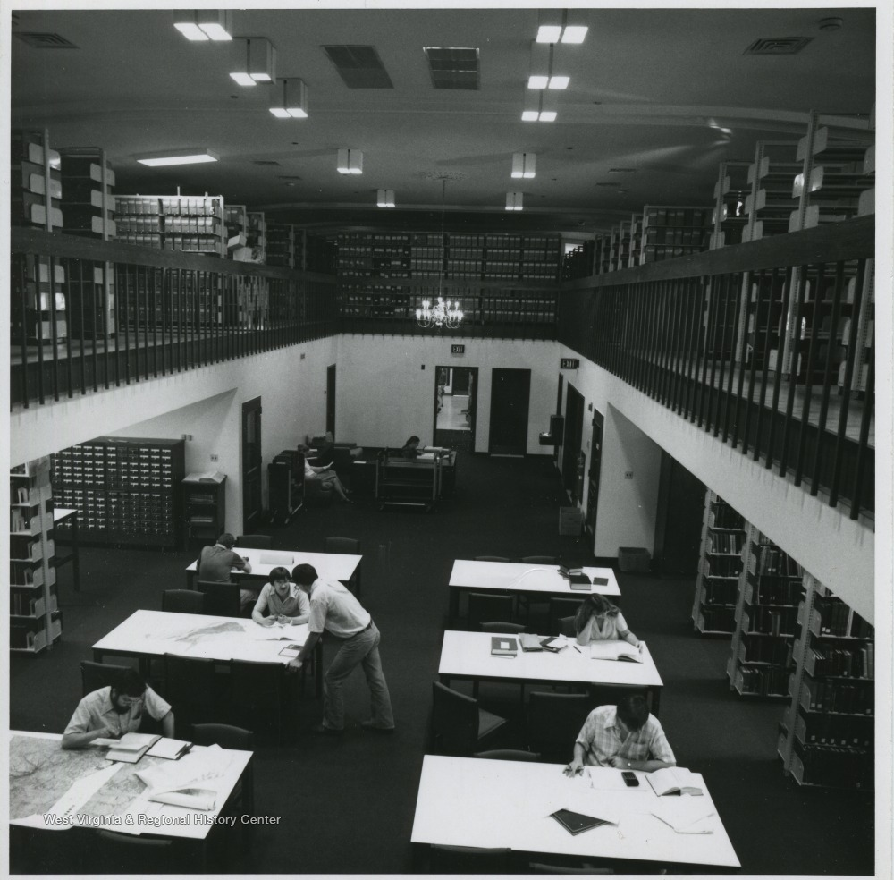 View down into a library reading room, from the mezzanine level.