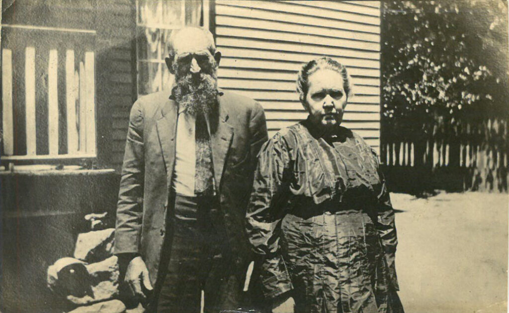 Man and woman standing outside a home