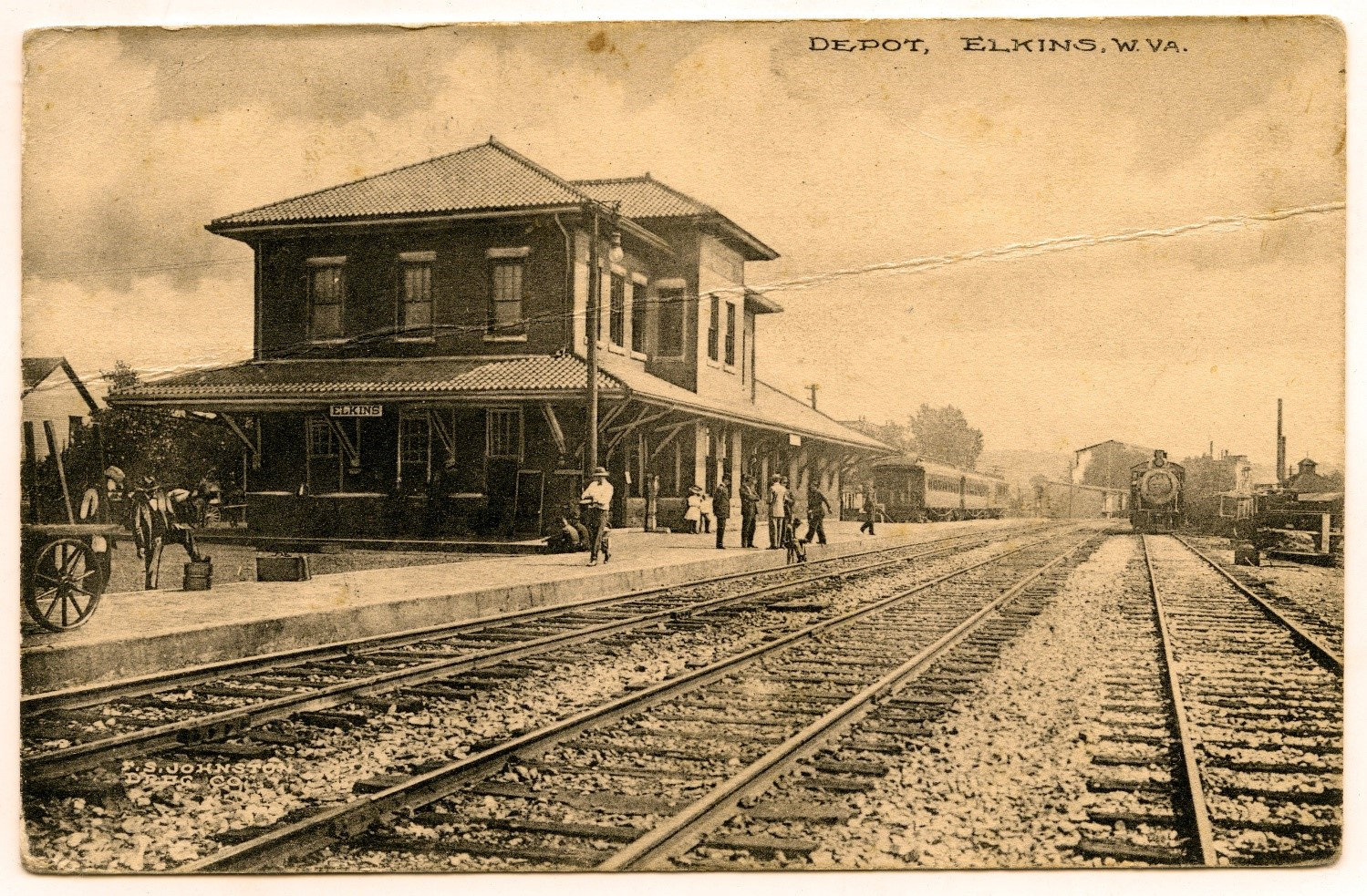 Sepia image of train depot, with some trains pulling in or out