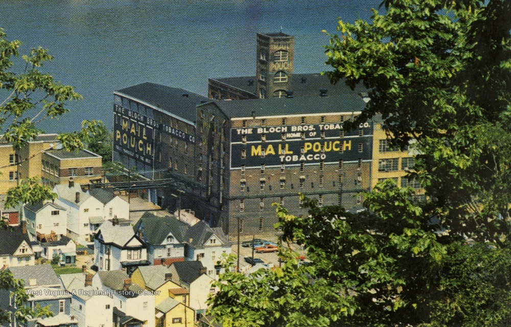 "Warehouse or factory building with ""Mail Pouch Tobacco"" painted on the sides."