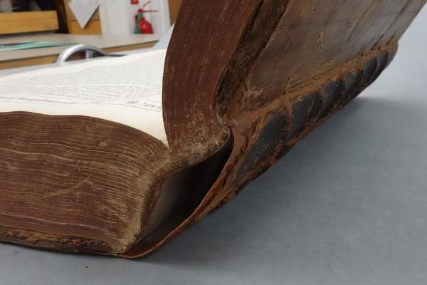 Close up view of the spine of an open hardcover book