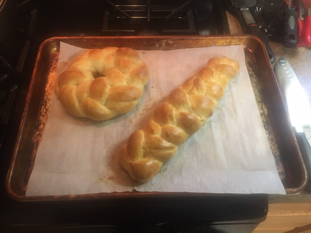 Ring and loaf of baked, braided dough
