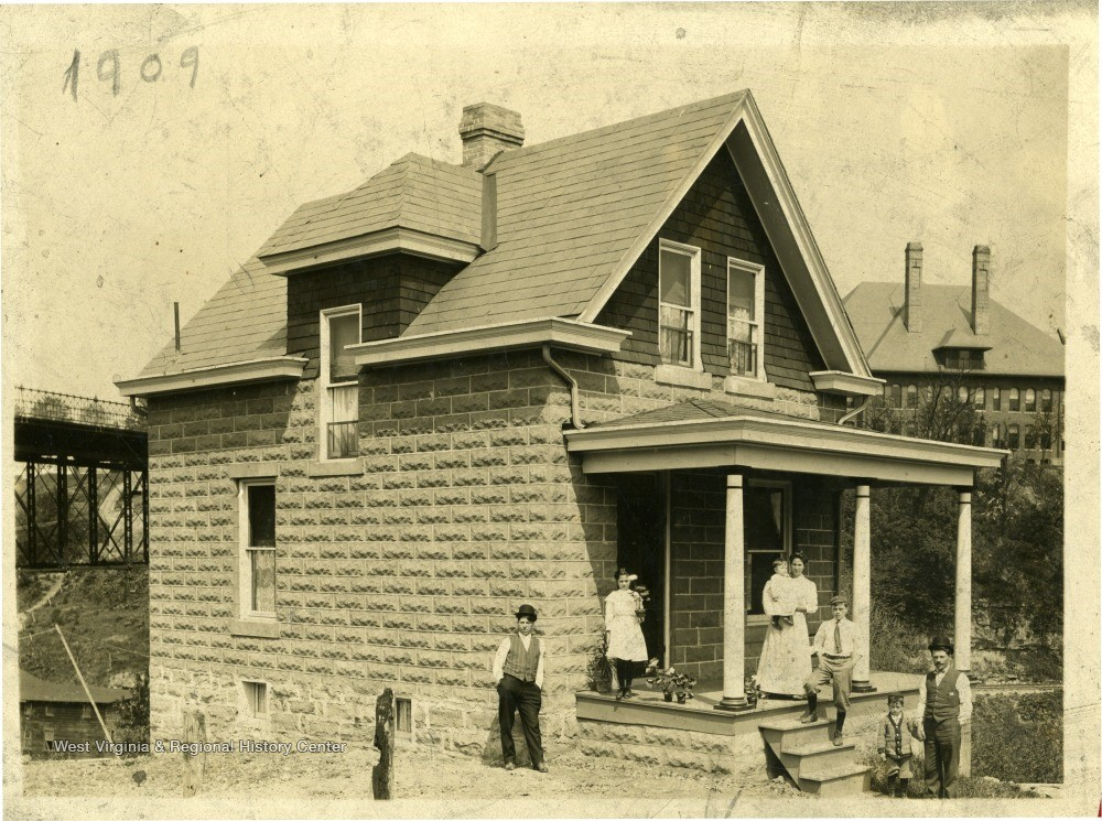 House with family gathered on and around the front porch