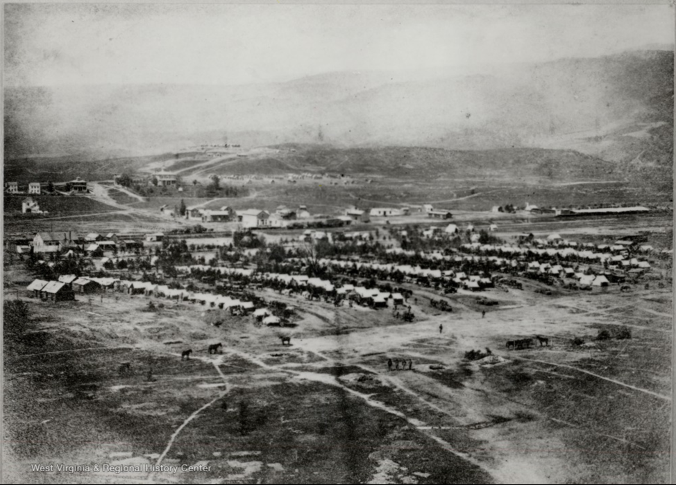 Tents in rows with town in background