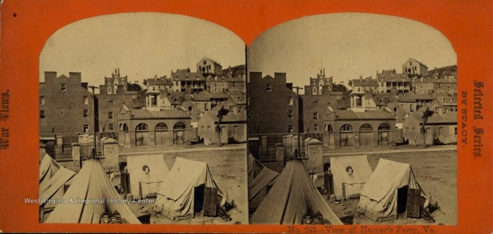 Stereograph card showing tents in front of the Harpers Ferry engine house